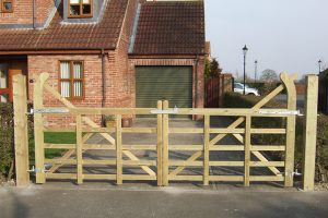 Image showing a pair of wooden gates on a customers driveway